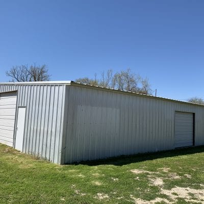 REDUCED – Warehouse and  little over 1/2 acre in Meridian